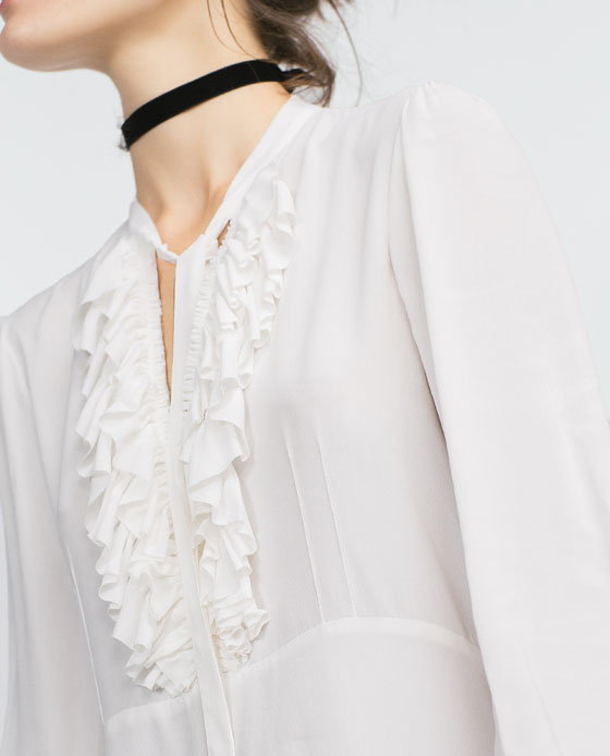 White-frilly_blouse